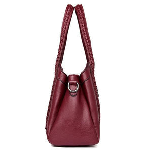 lateral red leather handbag
