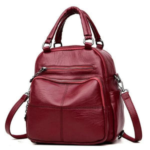 Red leather purse backpack