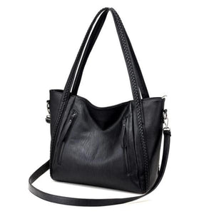 Black leather tote bag with zipper and shoulder strap