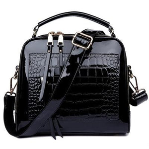 Black shiny leather crossbody bags with two zipper compartments