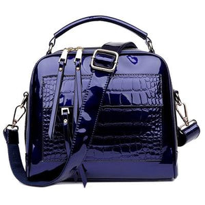 Blue shiny leather crossbody bags with two zipper compartments