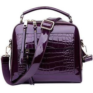 Purple shiny leather crossbody bags with two zipper compartments