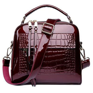 Red shiny leather crossbody bags with two zipper compartments