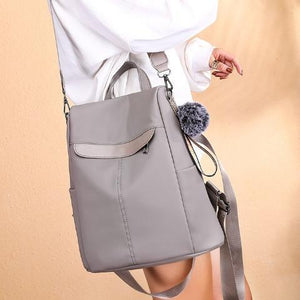 Gray backpack with shoulder strap for women