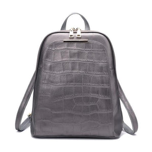 Silver alligator leather backpack with convertible strap