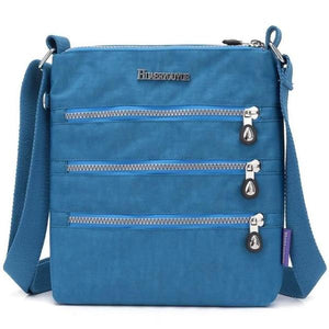 Blue nylon multi pocket small crossbody bag