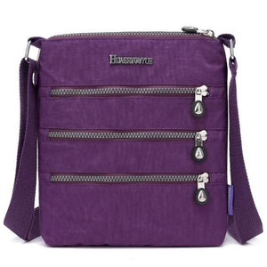 Purple nylon multi pocket small crossbody bag
