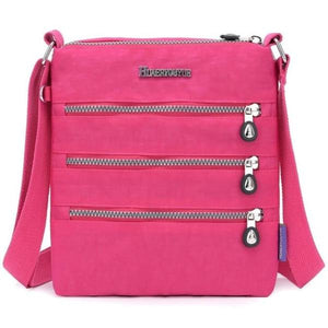 Hot pink nylon multi pocket small crossbody bag