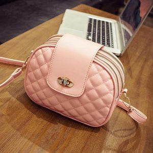 Pink crossbody bag with triple zipper pocket