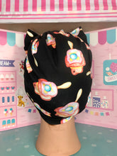 Load image into Gallery viewer, Bubble O Bill on black head wrap