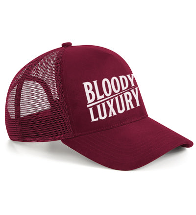 Bloody Luxury suede snapback trucker in burgundy with the Bloody Luxury logo and spotlights a luxurious suede finish.