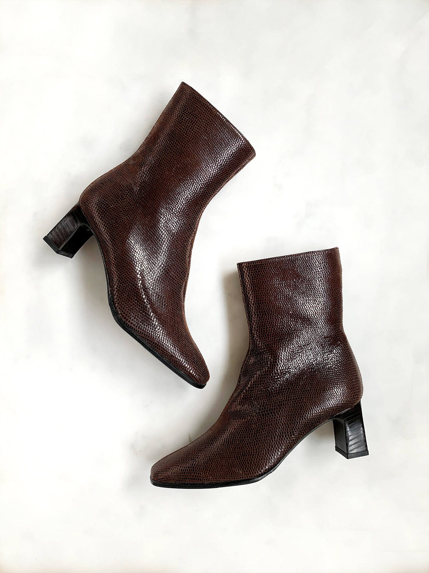 A pair of dark brown vintage 1990s ankle boots in mint unworn condition made from lizard effect leather