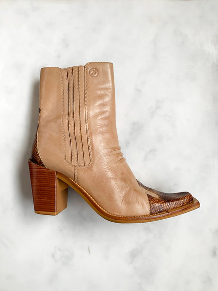 A pair of vintage Y2K tan leather cowboy boots with snake detail at the toe
