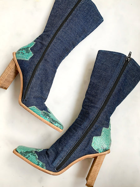 An incredible pair of rare vintage Y2K blue denim heeled cowboy boots.