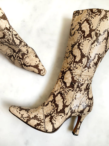 A pair of vintage 1990s beige python-print boots with high flared heels