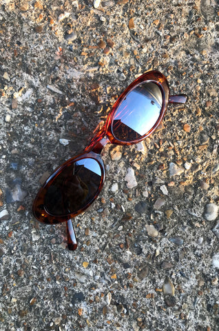 Tortoiseshell narrow oval sunglasses with reflective lenses by Human Sea Vintage