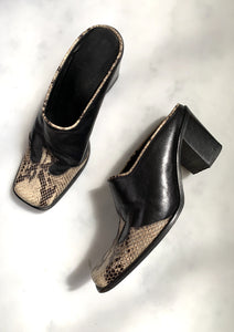 A pair of rare vintage Y2K black cowboy mules with snakeskin toe