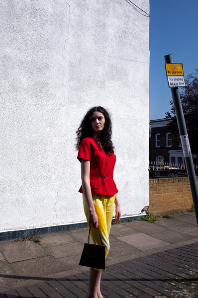 Rosalind Jana wears red peplum jacket and yellow Capri pants for Human Sea Vintage