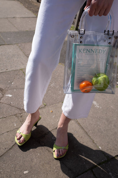Rosalind Jana wears white vintage Escada jeans with lime-green mules and see-through Suzy Smith bag for Human Sea Vintage