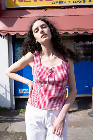 Rosalind Jana wears square-neck gingham tank top and white Escada jeans for Human Sea Vintage