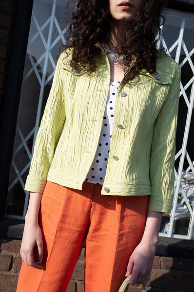 Rosalind Jana wears lime-green crinkle jacket and polka-dot camisole by Human Sea Vintage