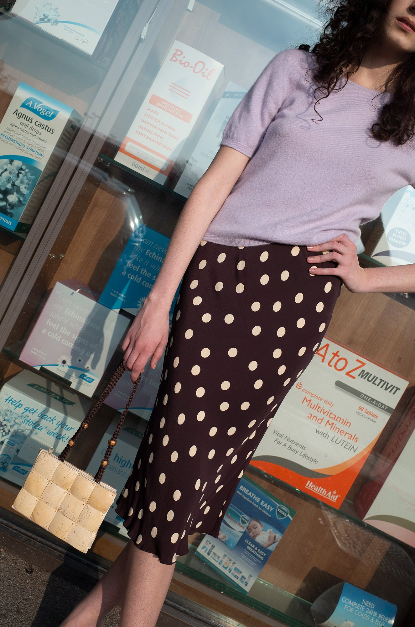 Rosalind Jana wears lilac cashmere short-sleeve jumper with brown polka dot slip skirt by Human Sea Vintage
