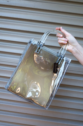 See-through Suzy Smith bag with gold ombre lining and lucite handles