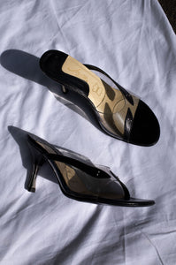 1980s black leather vinyl stiletto mules with novelty snake embellishment by Human Sea Vintage