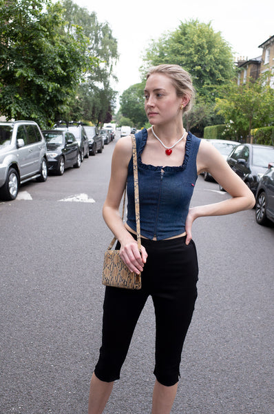 Model wears chic black high-waisted capri pants by Human Sea Vintage
