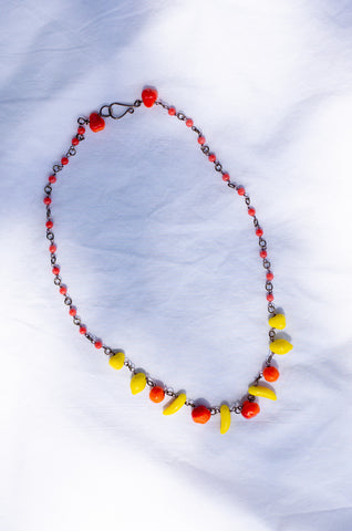 Yellow and orange glass necklace featuring banana, lemon, pear and apple beads by Human Sea Vintage