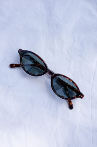 1990s DKNY tortoiseshell small oval sunglasses by Human Sea Vintage