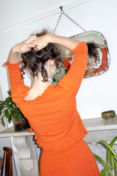 Model wears vintage orange knitted dress set by Human Sea Vintage