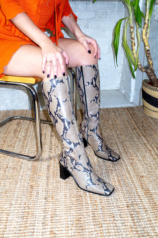 Model wears vintage snake print leather boots by Human Sea Vintage