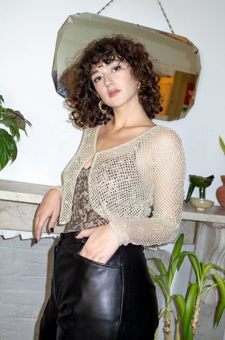 Model wears vintage gold lurex knitted cardigan by Human Sea Vintage