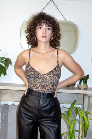 Model wears vintage snake print bodysuit by Human Sea Vintage