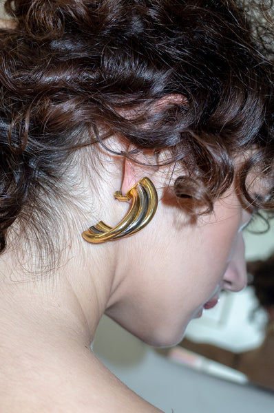 Model wears vintage three tone twist earrings by Human Sea Vintage