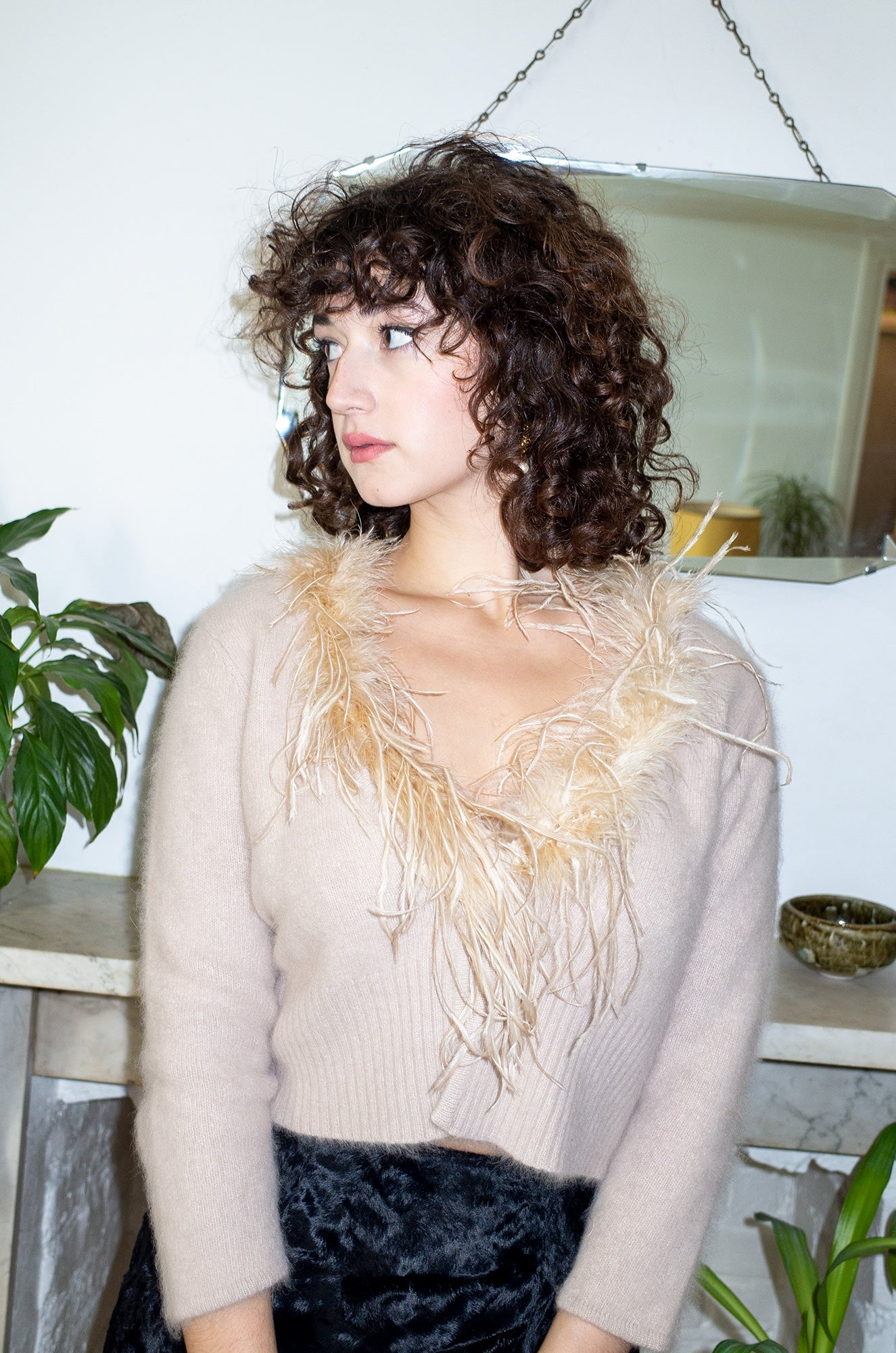 Model wears vintage ostrich trim angora cardigan by Human Sea Vintage