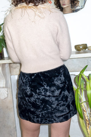 Vintage wears black faux fur miniskirt by Human Sea Vintage