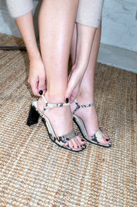 Model wears vintage snake print leather sandals by Human Sea Vintage