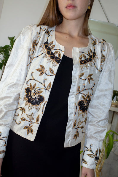 Model wears vintage ivory silk embellished beaded evening jacket