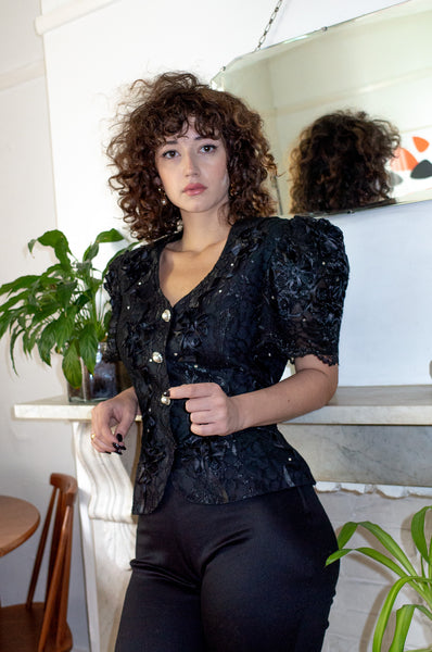 Model wears vintage black lace evening jacket by Human Sea Vintage