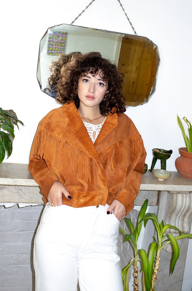 Model wears vintage tan suede western jacket by Human Sea Vintage