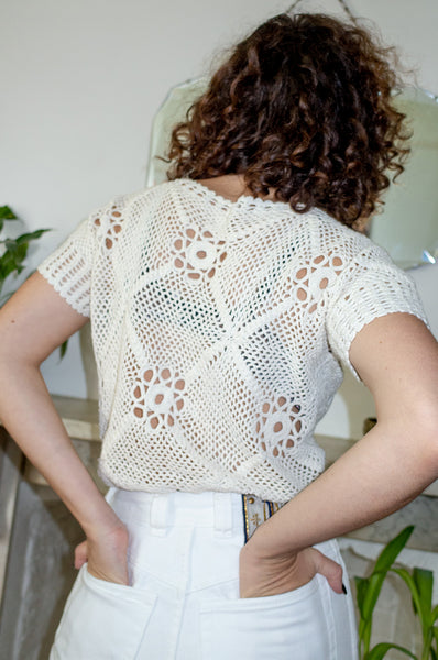 Model wears vintage cream crochet cotton top by Human Sea Vintage