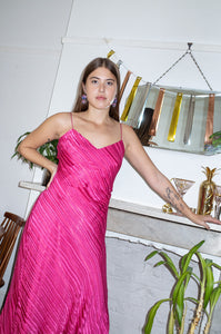 Model wears vintage pink silk slip dress by Human Sea Vintage