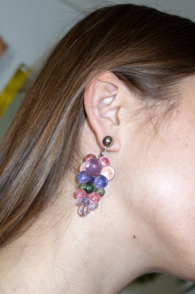 Model wears vintage bunch of grapes earrings by Human Sea Vintage