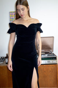 Model wears vintage black velvet Bardot dress by Human Sea Vintage