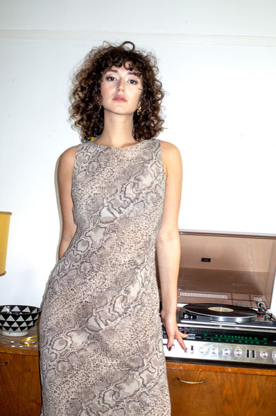 Model wears vintage snake print shift dress by Human Sea Vintage