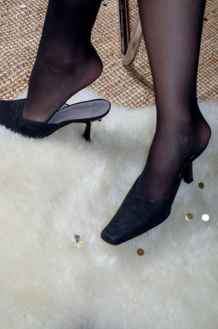 Model wears vintage black suede square mules by Human Sea Vintage