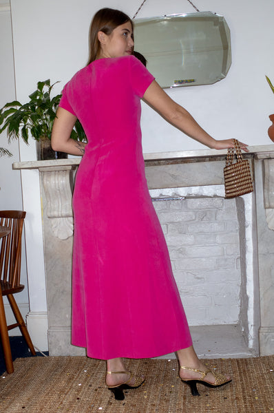 Model wears vintage hot pink silk maxi dress by Human Sea Vintage