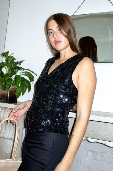 Model wears vintage black sequined waistcoat top by Human Sea Vintage